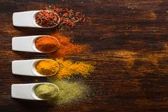 Colorful spices on brown wooden table Stock Photo