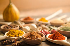 Colorful spices and dried herbs on wooden table Royalty Free Stock Image