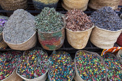 Colorful spices and flowers in a market shop in Marrakesh - Central Morocco Stock Photos