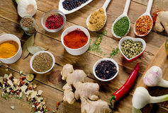 Colorful spices and fresh herbs on wooden table. Stock Photo
