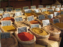 Colorful spices in jute bags at the local market . Tuscany, Italy Stock Image
