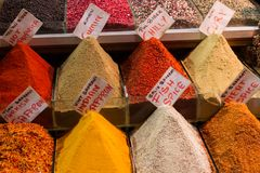 Colorful spices on a local street market. Istanbul, Turkey. Colorful spices on a local street market: f.e. saffron, cumin, chilly and curry. Istanbul, Turkey royalty free stock photos
