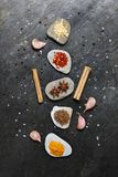 Colorful spices on pebbles in center linear group Royalty Free Stock Images