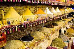 Traditional spices market - pots and wooden tubs stand in row with tea, spices, fruits, roots, flowers. Street bazaar. Colorful spices powders and herbs in Stock Photos