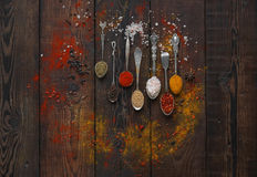 Colorful spices in spoons Royalty Free Stock Image