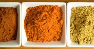 Colorful spices in square dishes Stock Photos