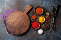 Colorful spices on stone table. And cooking utensils. Top view with space for your recipe stock image