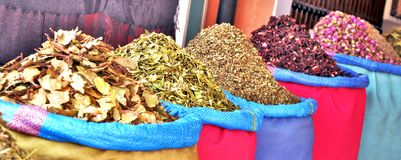 Spices and tasty treats in Moroccan market. Vegetarian delight. Perfume, tasty smell. Street market in Marrakech, Morocco, Africa. royalty free stock images