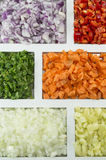 Colorful spices, vegetables and food ingredients ordered on a re Stock Photo