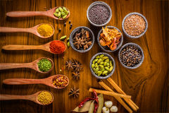 Colorful spices on wood Royalty Free Stock Images