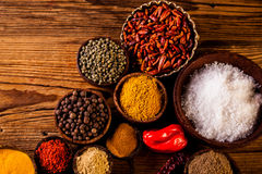 Colorful spices in wooden bowls Royalty Free Stock Image