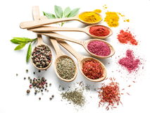Colorful spices in the wooden spoons on the white Stock Photo