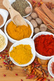 Colorful spices on wooden table Stock Photo