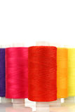 Colorful spindles of yarn Stock Images