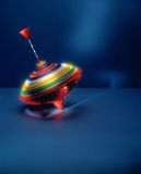 Colorful spinning top Stock Images