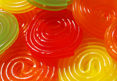 Colorful spiral candy. In  green, red and orange Royalty Free Stock Photos