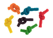 Colorful spiral licorice sticks tied in knots Stock Photo