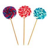 Colorful spiral lollipop. Isolated on white background royalty free stock images