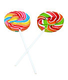 Colorful spiral lollipop candy on stick, isolated on white background. (clipping path) Royalty Free Stock Image
