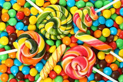Colorful spiral lollipop with chocolate coated candy Royalty Free Stock Images