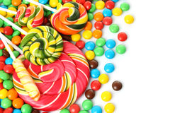 Colorful spiral lollipop with chocolate coated candy Stock Images