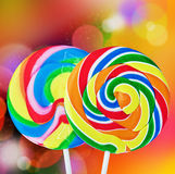 Colorful spiral lollipop isolated on a colored Stock Images