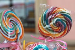 Colorful spiral lollipops Stock Photos
