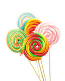 Colorful spiral lollipops on white background Royalty Free Stock Images