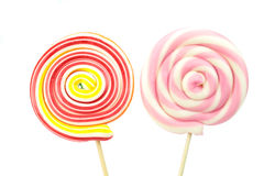 Colorful spiral lollipops on white background Stock Images