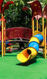 Colorful Spiral Tube Slide with Green Elastic Rubber Floor. For Children in the Park Stock Photography
