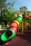 Colorful spiral tube slide at public playground . Stock Image