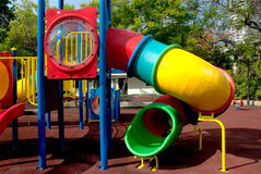 Colorful spiral tube slide at public playground . Stock Photography