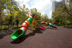 Colorful spiral tube slide at public playground . Royalty Free Stock Photography