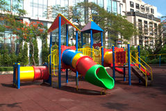 Colorful spiral tube slide at public playground . Royalty Free Stock Photo
