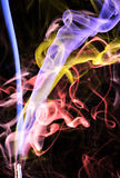Colorful Spirls of Incense Smoke Stock Images