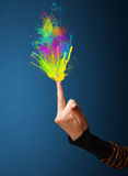 Colorful splashes are coming out of gun shaped hands Stock Photos