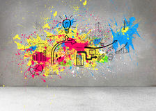 Colorful splashes on grey wall with graphics Stock Photography