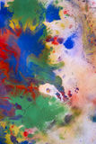 Colorful splashes on white paper conveyed over Stock Photography