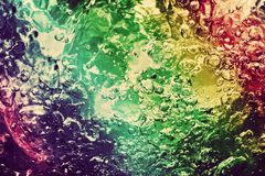 Colorful splashing, pouring water with bubbles Royalty Free Stock Photography