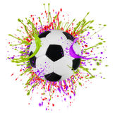 Colorful splashing with soccer ball Royalty Free Stock Image