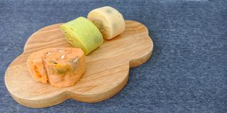 The colorful sponge cake roll`s gone moldy. stock photography