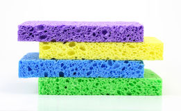 Colorful Sponge Stack. A stack of four colorful cleaning sponges against a white background stock image