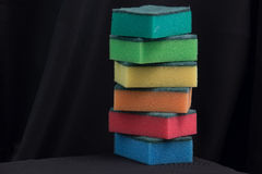 Colorful sponges. On black cloth background Royalty Free Stock Image