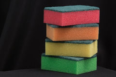 Colorful sponges. On black cloth background Royalty Free Stock Photos