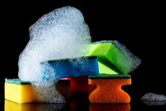 Colorful sponges with  foam and reflection, bubbles, isolated on black Stock Photography
