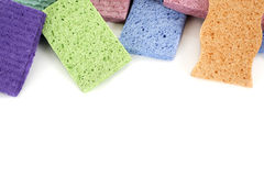 Colorful sponges. A group of colorful sponges against a white background that leaves copy space stock image