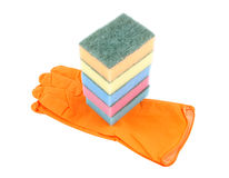 Colorful sponges on rubber glove Stock Photography