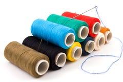Colorful spools of thread stock photo
