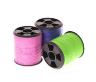 Colorful spools of thread isolated on white Royalty Free Stock Photography