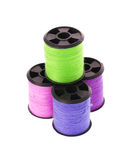 Colorful spools of thread isolated on white Royalty Free Stock Images